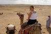 Camel ride by Egyptian PYRAMIDS